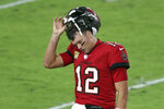 Tampa Bay Buccaneers quarterback Tom Brady (12) reacts as he leaves the field after throwing an interception against the New Orleans Saints during the second half of an NFL football game Sunday, Nov. 8, 2020, in Tampa, Fla. (AP Photo/Mark LoMoglio)