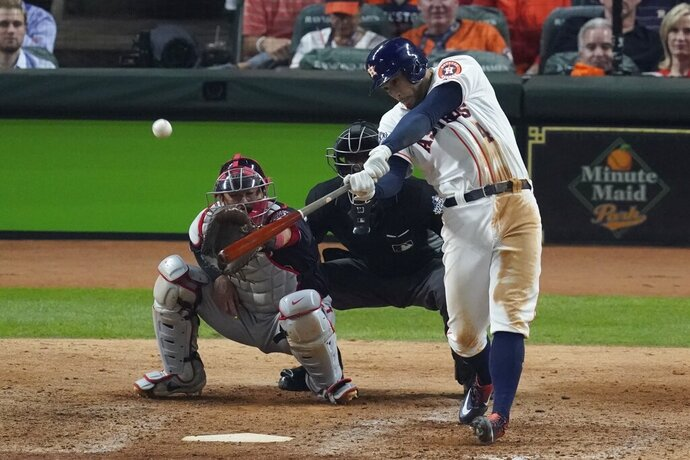 Houston Astros' George Springer hits an RBI double during the eighth inning of Game 1 of the baseball World Series against the Washington Nationals Tuesday, Oct. 22, 2019, in Houston. (AP Photo/Eric Gay)
