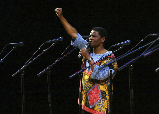 FILE - In this Sunday Jan. 20, 2008 file photo, Ladysmith Black Mambazo founding member Joseph Shabalala gestures to the audience during the group's performance at the Kimmel Center in Philadelphia. The founder of the South African multi-Grammy-Award-winning music group Ladysmith Black Mambazo, Joseph Shabalala, has died at age 78. Shabalala died at a hospital in the capital Pretoria Tuesday Feb. 11, 2020, his family confirmed to local media. (AP Photo/Joseph Kaczmarek, File)