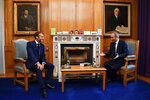 French President Emmanuel Macron, left, meets Ireland's Prime Minister Micheal Martin in Dublin, Ireland, Thursday, Aug. 26, 2021. French President Emmanuel Macron is on Thursday on his first visit to Ireland, where talks are expected to focus on the situation in Afghanistan and European issues. (Clodagh Kilcoyne/Pool Photo via AP)