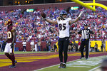 Baltimore Ravens tight end Eric Tomlinson (85) celebrates making a touchdown catch against Washington Football Team cornerback Jimmy Moreland (20) during the first half of a preseason NFL football game, Saturday, Aug. 28, 2021, in Landover, Md. (AP Photo/Carolyn Kaster)