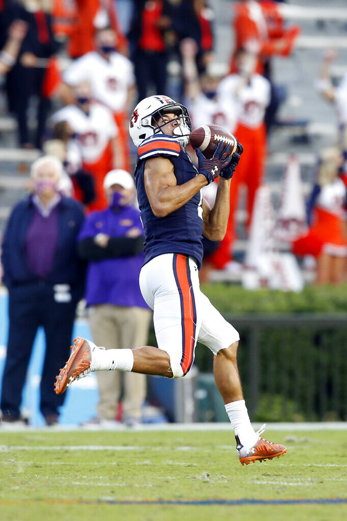 Auburn wide receiver Anthony Schwartz catches a pass for a touchdown during the second half of the team's NCAA college football game against LSU on Saturday, Oct. 31, 2020, in Auburn, Ala. (AP Photo/Butch Dill)