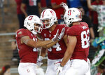 Stanford wide receiver JJ Arcega-Whiteside, left, celebrates with teammates Colby Parkinson (84) and Kaden Smith (82) after scoring a touchdown against San Diego State during the first half of an NCAA college football game Friday, Aug. 31, 2018, in Stanford, Calif. (AP Photo/Tony Avelar)