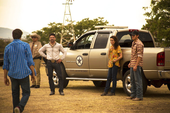 This image released by IFC Films shows, from second left, George Lopez, Frank Grillo, Andie McDowell and Jake Allyn in a scene from