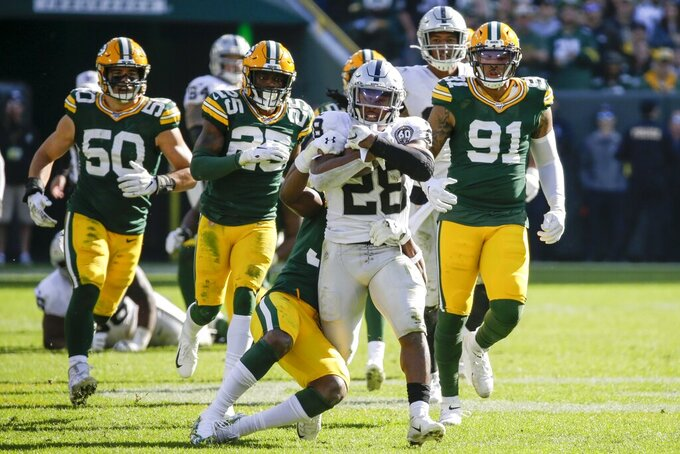 Oakland Raiders' Josh Jacobs runs during the second half of an NFL football game against the Green Bay Packers Sunday, Oct. 20, 2019, in Green Bay, Wis. (AP Photo/Mike Roemer)