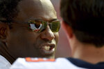 Syracuse head coach Dino Babers speaks with quarterback Tommy DeVito (13) during the second half of an NCAA college football game against Maryland, Saturday, Sept. 7, 2019, in College Park, Md. (AP Photo/Will Newton)