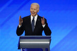 Former Vice President Joe Biden speaks during a Democratic presidential primary debate, Friday, Feb. 7, 2020, hosted by ABC News, Apple News, and WMUR-TV at Saint Anselm College in Manchester, N.H. (AP Photo/Elise Amendola)