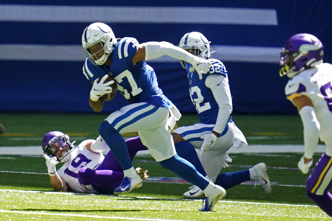 Indianapolis Colts' Khari Willis (37) runs back in interception during the first half of an NFL football game against the Minnesota Vikings, Sunday, Sept. 20, 2020, in Indianapolis. (AP Photo/Michael Conroy)