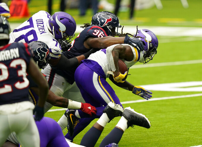 Minnesota Vikings running back Dalvin Cook (33) breaks away from Houston Texans defensive end P.J. Hall (96) to score a touchdown during the first half of an NFL football game Sunday, Oct. 4, 2020, in Houston. (AP Photo/David J. Phillip)