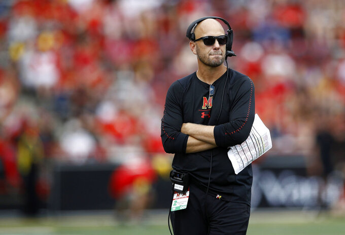 FILE - In this Sept. 22, 2018, file photo, Maryland interim coach Matt Canada stands on the field during a timeout in the second half of the team's NCAA college football game against Minnesota in College Park, Md. Canada knows it's going to be a challenge to pull off the upset against No. 9 Ohio State on Saturday, but hopes his team appreciates the opportunity. (AP Photo/Patrick Semansky, File)