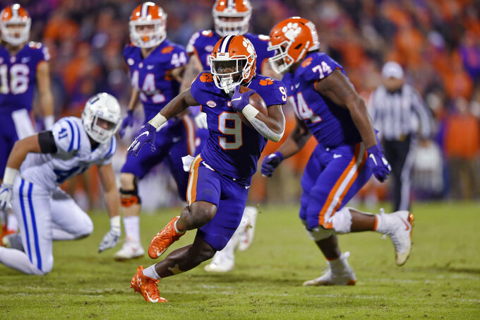Clemson's Travis Etienne rushes out of the backfield during the second half of an NCAA college football game against Duke on Saturday, Nov. 17, 2018, in Clemson, S.C. (AP Photo/Richard Shiro)