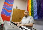 Chuck Erickson plays the organ during a worship service at Angels of Hope Metropolitan Community Church Sunday, Aug. 18, 2019 in Kaukauna, Wis. . (Danny Damiani/The Post-Crescent via AP)