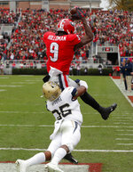 Georgia wide receiver Jeremiah Holloman (9) makes a catch for a touchdown as Georgia Tech defensive back Malik Rivera (36) defends during the first half of an NCAA college football game Saturday, Nov. 24, 2018, in Athens, Ga. (AP Photo/John Bazemore)