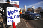 A sign marks the lane for motorists to drop off ballots at the drive-through site of the Denver Election Division outside the City/County Building early Tuesday, Nov. 5, 2019, in downtown Denver. (AP Photo/David Zalubowski)