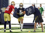 Notre Dame's running back Kyren Williams runs through a drill during the team's first spring NCAA college football practice at the Irish Athletics Center, Thursday, March 5, 2020, in South Bend, Ind. (Santiago Flores/South Bend Tribune via AP)