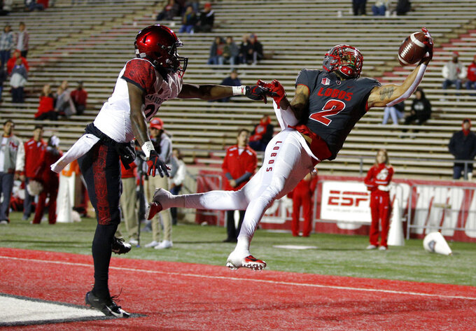 New Mexico wide receiver Delane Hart-Johnson (2) pulls in a touchdown catch as San Diego State cornerback Darren Hall (23) defends during the second half of an NCAA college football game in Albuquerque, N.M., Saturday, Nov. 3, 2018. San Diego State won 31-23. (AP Photo/Andres Leighton)