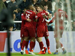 Liverpool players celebrate after Divock Origi, rear center, scored their third goal against Newcastle United during the Premier League soccer match at St James' Park, in Newcastle, England, Saturday May 4, 2019. (Owen Humphreys/PA via AP)