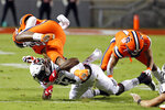 Syracuse's Abdul Adams (23) is upended by North Carolina State's Tyler Baker-Williams (13) during the first half of an NCAA college football game in Raleigh, N.C., Thursday, Oct. 10, 2019. (AP Photo/Karl B DeBlaker)