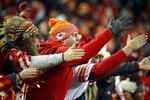 """FILE - In this Dec. 13, 2018, photo, Kansas City Chiefs fans chant and do the chop during the second half of the team's NFL football game against the Los Angeles Chargers in Kansas City, Mo. The Kansas City Chiefs have since barred headdresses and war paint amid the nationwide push for racial justice, but its effort to make its popular """"war chant"""" more palatable is getting a fresh round of scrutiny from Native American groups as the team prepares to make its second straight Super Bowl appearance. (AP Photo/Charlie Riedel, File)"""