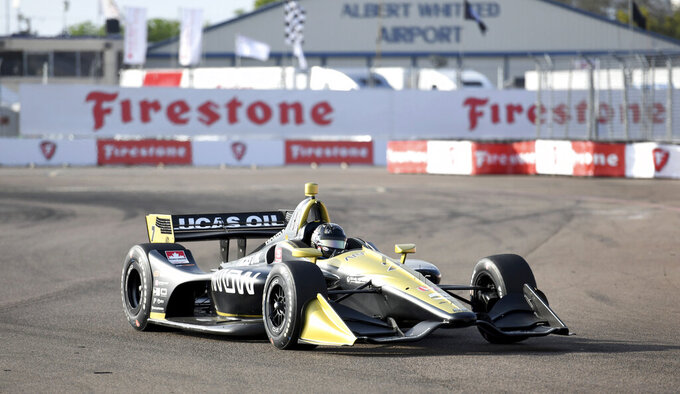 The Latest: Newgarden gives Roger Penske yet another win