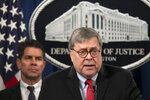 Attorney General William Barr, right, next to FBI Deputy Director David Bowdich, speaks during a news conference, Monday, Feb. 10, 2020, at the Justice Department in Washington.  Four members of the Chinese military have been charged with breaking into the networks of the Equifax credit reporting agency and stealing the personal information of tens of millions of Americans, the Justice Department said Monday, blaming Beijing for one of the largest hacks in history.   (AP Photo/Jacquelyn Martin)