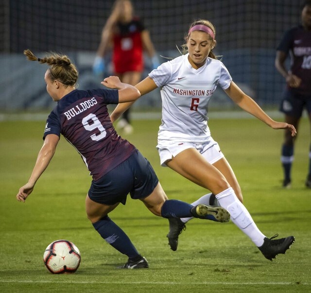 In this Sept. 5, 2019, photo, Washington State forward Morgan Weaver (6) competes for the ball with Gonzaga's Maddie Cooley (9) during a college soccer match in Spokane, Wash. Weaver was selected by the Portland Thorns with the second pick in the National Women's Soccer League draft, The league was supposed to start its season this weekend. (Colin Mulvany/The Spokesman-Review via AP)