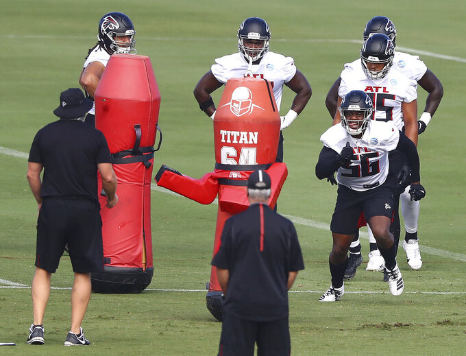 Atlanta Falcons defensive end Dante Fowler (56) runs a drill during NFL football training camp on Wednesday, Aug. 19, 2020, in Flowery Branch, Ga. (Curtis Compton/Atlanta Journal-Constitution via AP, Pool)