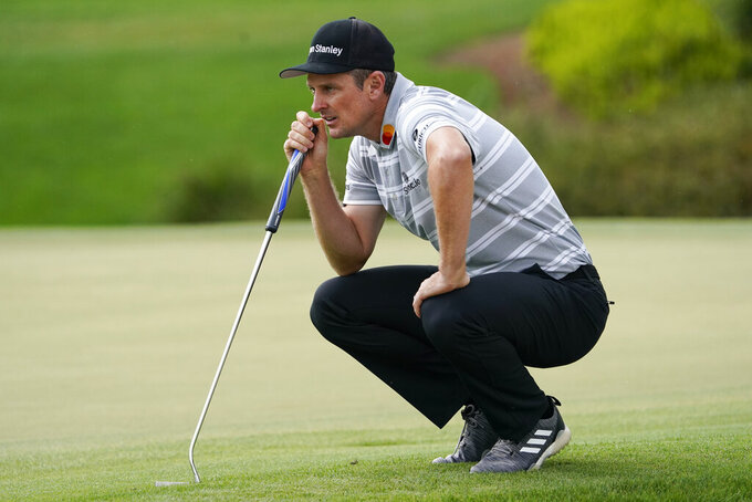 Justin Rose, of England, lines up a putt on the second green during the third round of the Arnold Palmer Invitational golf tournament Saturday, March 6, 2021, in Orlando, Fla. (AP Photo/John Raoux)