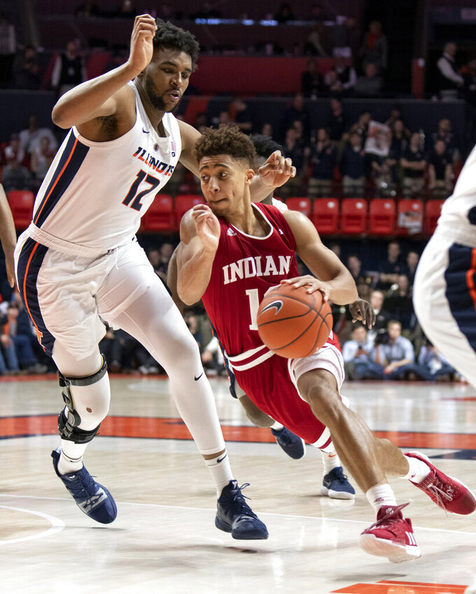 Indiana guard Rob Phinisee (10) drives to the basket past Illinois center Adonis De La Rosa (12) during the second half of an NCAA college basketball game in Champaign, Ill., Thursday, March 7, 2019. (AP Photo/Stephen Haas)