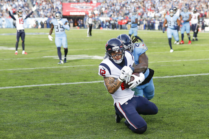 Houston Texans wide receiver Kenny Stills (12) catches a 16-yard touchdown pass as he is defended by Tennessee Titans cornerback Tye Smith (23) in the first half of an NFL football game Sunday, Dec. 15, 2019, in Nashville, Tenn. (AP Photo/James Kenney)