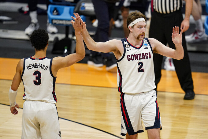 Gonzaga forward Drew Timme (2) celebrates with guard Andrew Nembhard (3) in the second half of a second-round game against Oklahoma in the NCAA men's college basketball tournament at Hinkle Fieldhouse in Indianapolis, Monday, March 22, 2021. (AP Photo/Michael Conroy)