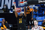 Norfolk State forward J.J. Matthews (15) dunks on Gonzaga forward Drew Timme (2) during the second half of a men's college basketball game in the first round of the NCAA tournament at Bankers Life Fieldhouse in Indianapolis, Saturday, March 20, 2021. (AP Photo/Paul Sancya)