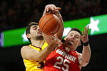 Minnesota forward Alihan Demir (30) and Ohio State forward Kyle Young (25) battle for a rebound in the first half of an NCAA basketball game Sunday, Dec. 15, 2019, in Minneapolis. (AP Photo/Andy Clayton-King)