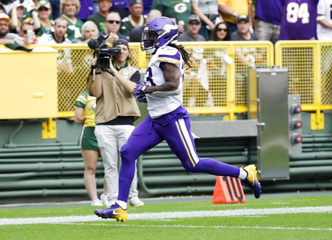 Cook sets career rushing high in Vikings' loss to Packers