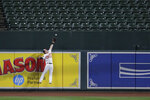 Baltimore Orioles center fielder Austin Hays leaps at the wall, catching a ball hit by Toronto Blue Jays' Vladimir Guerrero Jr. during the fourth inning of a baseball game Thursday, Sept. 19, 2019, in Baltimore. (AP Photo/Julio Cortez)