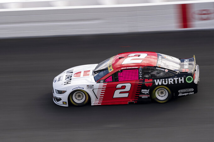 Brad Keselowski (2) drives during a NASCAR Cup Series auto racing race at Charlotte Motor Speedway, Sunday, Oct. 10, 2021, in Concord, N.C. (AP Photo/Matt Kelley)