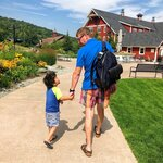 This Aug. 25, 2018 photo shows Jay Collins, of New York, right, with his nephew Owen Kubursi, 4, at Sugarbush Resort in Warren, Vt. The popular ski resort offers mountain biking, a bungee trampoline and a zip line during the summer season. (Jay Collins via AP)