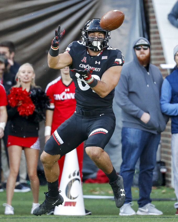 Cincinnati tight end Josiah Deguara (83) catches a pass in the first half of an NCAA college football game against Navy, Saturday, Nov. 3, 2018, in Cincinnati. (AP Photo/John Minchillo)