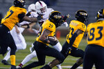 Southern Mississippi's Camron Harrell (29) returns a kickoff for a touchdown during the second half against Florida Atlantic in an NCAA college football game, Thursday, Dec. 10, 2020, in Hattiesburg, Miss. (AP Photo/Rogelio V. Solis)
