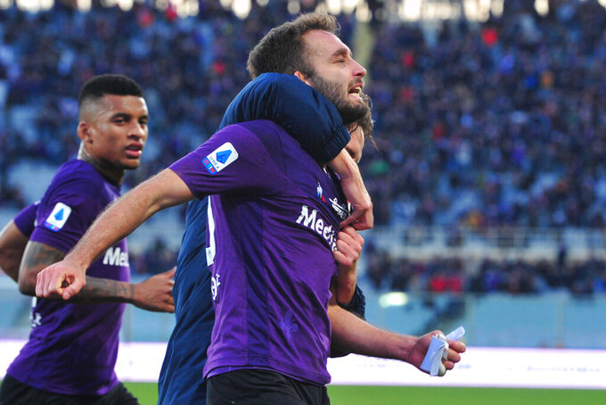 "FILE - In this Sunday, Jan. 12, 2020 file photo, Fiorentina's German Pezzella celebrates after scoring during the Italian Serie A soccer match between Fiorentina and Spal, at the Artemio Franchi stadium in Florence, Italy. Two more Fiorentina players have tested positive for COVID-19 as well as a club physiotherapist. The top-tier Italian league team tweets that defender and club captain Germán Pezzella, forward Patrick Cutrone and physiotherapist Stefano Dainelli ""are in good health at their homes in Florence. For most people, the new coronavirus causes only mild or moderate symptoms. For some, it can cause more severe illness, especially in older adults and people with existing health problems. (Jennifer Lorenzini/LaPresse via AP, File )"