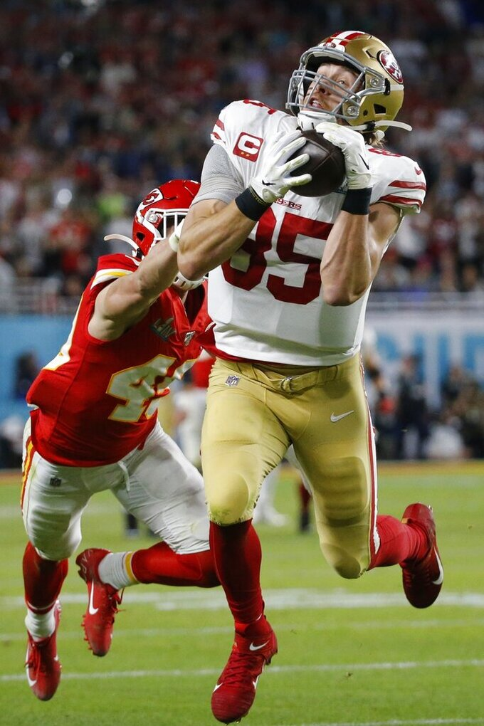 San Francisco 49ers' George Kittle (85) catches a pass in front of Kansas City Chiefs' Daniel Sorensen during the first half of the NFL Super Bowl 54 football game Sunday, Feb. 2, 2020, in Miami Gardens, Fla. The play was called back on a penalty by Kittle. (AP Photo/Mark Humphrey)