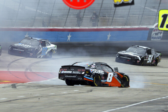 Jeb Burton (8) spins out on to pit road during a NASCAR Xfinity Series auto race at Texas Motor Speedway in Fort Worth, Texas, Saturday Oct. 24, 2020. (AP Photo/Richard W. Rodriguez)