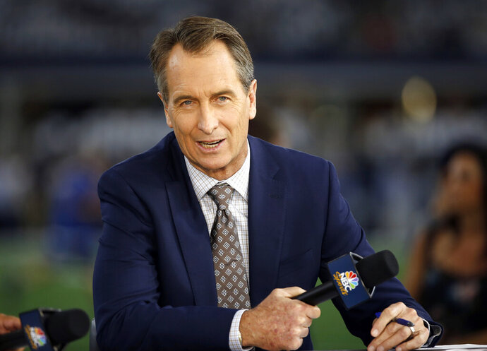 FILE - In this Oct. 30, 2016, file photo, NBC Sunday Night Football cast member Cris Collinsworth sits on the set during pregame of an NFL football game between the Philadelphia Eagles and the Dallas Cowboys in Arlington, Texas. Collinsworth will call his first Sunday Night game in Cleveland when the Browns take on the Los Angeles Rams. Cleveland holds a special place in Collinsworth's heart because it was where he called his first NFL game in 1990. (AP Photo/Ron Jenkins, File)