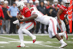 Wisconsin defensive lineman Keeanu Benton, right, sacks Ohio State quarterback Justin Fields during the first half of an NCAA college football game Saturday, Oct. 26, 2019, in Columbus, Ohio. (AP Photo/Jay LaPrete)