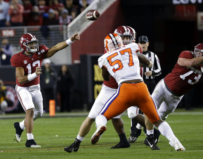Alabama's Tua Tagovailoa throws during the first half the NCAA college football playoff championship game against Clemson, Monday, Jan. 7, 2019, in Santa Clara, Calif. (AP Photo/David J. Phillip)