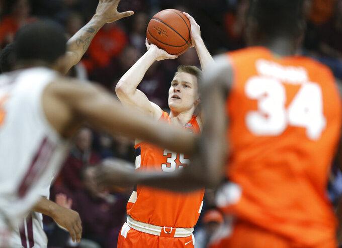 Syracuse's Buddy Boeheim (35) shoots over the Virginia Tech defense during the first half of an NCAA college basketball game in Blacksburg Va., Saturday, Jan. 18 2020. (Matt Gentry/The Roanoke Times via AP)