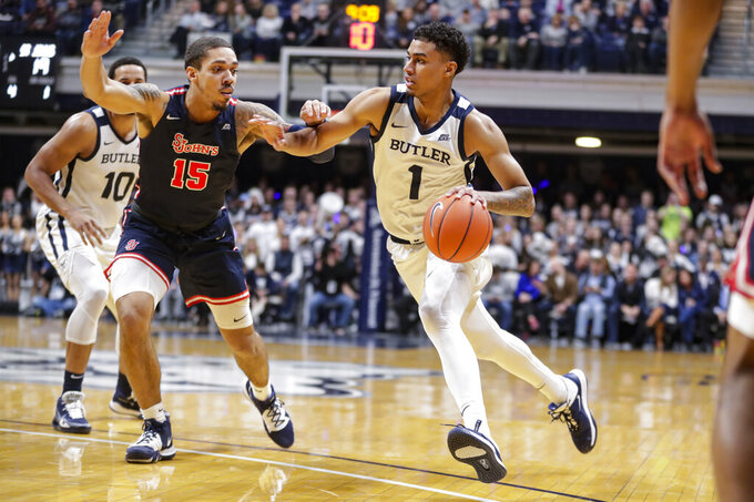 Butler forward Jordan Tucker (1) drives on St. John's forward Damien Sears (15) during the first half of an NCAA college basketball game in Indianapolis, Wednesday, March 4, 2020. (AP Photo/Michael Conroy)