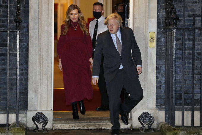 """FILE - In this file photo dated Wednesday, Feb. 3, 2021, Britain's Prime Minister Boris Johnson and his partner Carrie come out to clap on the doorstep of 10 Downing Street to honour Captain Tom Moore, in London.  In a post on Instagram, Carrie Johnson has said she feels """"incredibly blessed to be pregnant again"""", expecting the couple's second child.(AP Photo/Kirsty Wigglesworth)"""