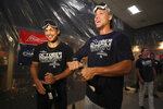 New York Yankees' Giancarlo Stanton, left, and Aaron Judge celebrate after defeating the Los Angeles Angels and clinching the AL East baseball title, Thursday, Sept. 19, 2019, in New York. (AP Photo/Mary Altaffer)