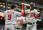 Washington Nationals' Kurt Suzuki, right, celebrates with Brian Dozier (9) after hitting a two-run home run off San Francisco Giants pitcher Conner Menez during the third inning of a baseball game Tuesday, Aug. 6, 2019, in San Francisco. (AP Photo/Ben Margot)